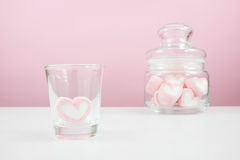 The lovely pink heart marshmallows on white table Stock Images