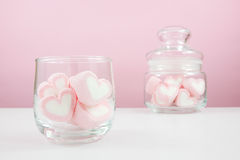 The lovely pink heart marshmallows on white table Royalty Free Stock Images