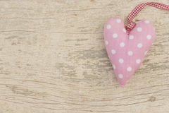 Lovely pink heart. With white dots on a shabby styled background Royalty Free Stock Image