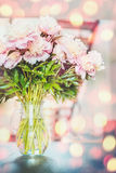 Lovely pink peonies flowers bunch in vase at sunshine bokeh Stock Photo
