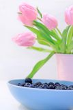 Lovely pink tulips and blueberries Stock Photo