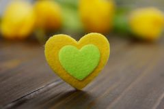Lovely pink yellow heart with romantic colorful tulips spring flowers decoration. stock photography