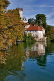 Lovely place. Middle-aged castle on a lake Annecy bank on a bright day royalty free stock photography