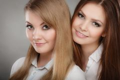 Lovely playful sisters women portrait. Royalty Free Stock Image