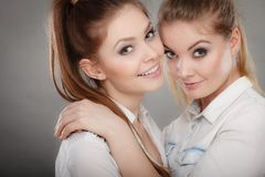 Lovely playful sisters women portrait. Stock Photos