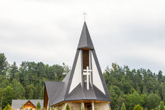 Lovely pointed rooftop of rustic village church Royalty Free Stock Image