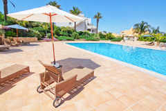 Lovely pool for holidays and umbrella sun beds. Stock Images