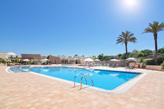 Lovely pool and hotel for a holiday vacation. Port Royalty Free Stock Photo