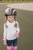 Lovely portrait of cute smiling blond girl skating Stock Photos