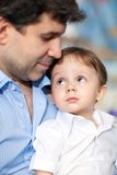 Lovely portrait of father and little son. Happy young dad with a little son. Child looking at beloved father with his big blue eyes royalty free stock images