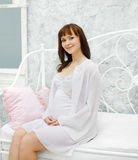 Lovely pregnant woman on the bed Stock Images