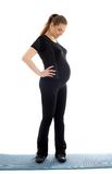 Lovely pregnant woman in black working out Royalty Free Stock Images