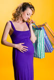 Lovely pregnant woman holding shopping bags Stock Images