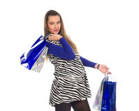 Lovely pregnant woman on shopping 6. Lovely pregnant woman wearing zebra pattern dress doing shopping Stock Photo