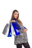 Lovely pregnant woman on shopping 8. Lovely pregnant woman wearing zebra pattern dress doing shopping Stock Photo