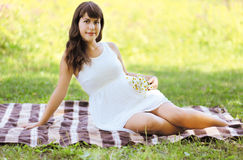 Lovely pregnant woman. In summer day royalty free stock photo