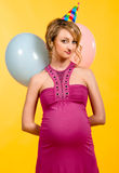 Lovely pregnant young woman with balloons Royalty Free Stock Photos
