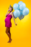 Lovely pregnant young woman with blue balloons Stock Photos