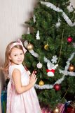 Lovely preschool girl decorating Christmas tree Stock Image
