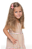 Lovely preschool girl on the white Royalty Free Stock Images