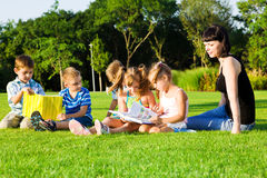 Lovely preschoolers with books Stock Photography