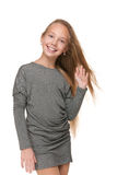 Lovely preteen girl. A portrait of a lovely preteen girl against the white background Royalty Free Stock Photo