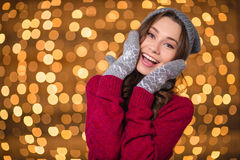 Lovely pretty cheerful female in grey hat and mittens posing Stock Images