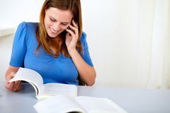 Lovely pretty woman speaking and browsing a book Stock Photos