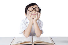 Lovely primary school student daydreaming Stock Photo