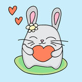 Lovely rabbit holds love heart Stock Images