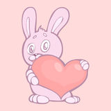 Lovely rabbit holds pink heart. Royalty Free Stock Photo