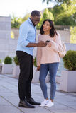 Lovely radiant girl giving her number to a handsome guy Royalty Free Stock Photography