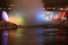 Lovely Rainbow Falls. Niagara Falls at Night with Rainbow of Colors royalty free stock photo