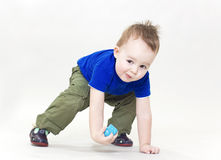 The lovely rascal. The little boy rises on a white background Stock Image