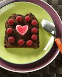 Lovely raspberryes and heart cake Royalty Free Stock Photos