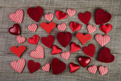 Lovely red checkered hearts on wooden background. Idea for a gre Stock Photography
