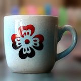 3d Effect Art Of A Colorful Ceramic Cup - 1. A lovely red flower design on light blue base perfect to create a lovely mood in your living room royalty free stock photography