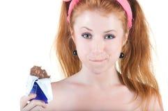 Lovely red-haired girl in dark blue sundress. Royalty Free Stock Photos