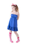 Lovely red-haired girl in  dark blue sundress. Stock Images
