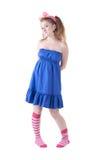 Lovely red-haired girl in  dark blue sundress. Stock Images