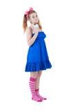 Lovely red-haired girl in dark blue sundress. Stock Photo