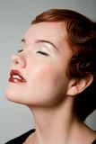 Lovely red-head young woman with closed eyes Stock Images