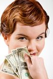 Lovely red-head young woman with dollars Stock Photo