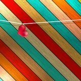 Lovely red heart hanging on clothesline. + EPS8 Stock Photography
