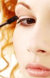 Lovely redhead applying black mascara Royalty Free Stock Image