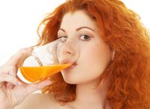 Lovely redhead drinking orange juice Royalty Free Stock Photo