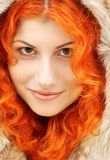 Lovely redhead in fur Royalty Free Stock Photos