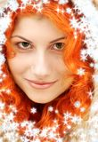 Lovely redhead in fur with snowflakes Stock Image