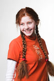 Lovely redhead girl with long braids Royalty Free Stock Photos