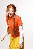 Lovely redhead girl with long braids Royalty Free Stock Images